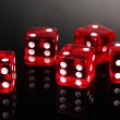 Red dices on grey background — Stock Photo #8749569