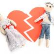 Two voodoo dolls boy and girl on the broken heart isolated on white — Stock Photo #8866587
