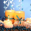 Beautiful candles, gifts and decor on wooden table on blue background — Stock Photo #9610325