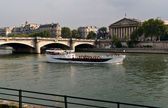 Excursion boat at the Seine in Paris — Stock Photo