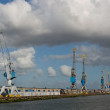 Stock Photo: Harbour cranes in Rotterdam port