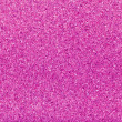 Coarse sand background texture  Macro of coarse sand grains pink — Stock Photo