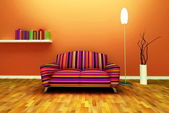 A contemporary colorful sofa in an interior — Stock Photo