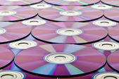Bunch of new colorful cd drive Close-up on background — Stock Photo