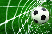 Soccer ball in goal — Stock Photo