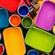 Pouring paints of CMYK colors from its buckets — Stock Photo #27187057