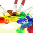 Pouring paints of CMYK colors from its buckets — Stock Photo #27187159