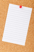 Written on an white sticky note pinned on a cork bulletin board — Stock Photo
