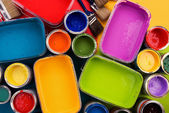 Pouring paints of CMYK colors from its buckets — Stock Photo