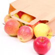 Shopping brown gift bags and apple isolated — Stock Photo