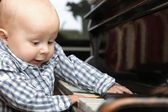 Beautiful little baby boy plays piano — Stock Photo