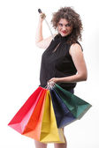 Lovely woman with shopping bags and sword — Stock Photo