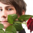 Young man, flower, red rose isolated — Stock Photo #18694507