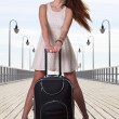 Beautiful woman girl sea mooring suitcase on a pier — Foto de Stock