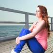 Attractive girl Young woman pier sea - Stock Photo