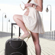 Beautiful woman girl sea mooring suitcase on a pier — Stok fotoğraf