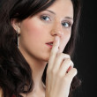 Young girl asking for silence — Stock Photo #19352943