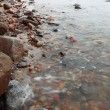 Stock Photo: FishermStones in sewater autumn
