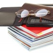 Glasses eBook reader pile of books, isolated on white — Stock Photo #19970879