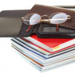 Glasses eBook reader pile of books, isolated on white — Stock Photo