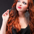 Stock Photo: Lovely redhead - Young beautiful red haired woman