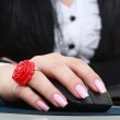 Woman hand with computer mouse — Stock Photo #21229867