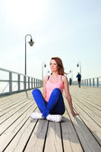 Attractive girl Young woman pier sea — Stock Photo