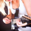 Woman with guitar headphones listening to music — Stock Photo