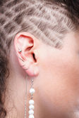 Ear super piercing woman — Stock Photo