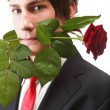 Young man, flower, red rose isolated — Stock Photo #22387305