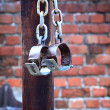 Stock Photo: Fetters, manacles on brick background