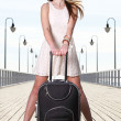 Beautiful woman girl sea mooring suitcase on a pier — Stock Photo
