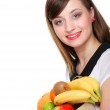 Healthy lifestyle - cheerful woman with fruit shopping paper bag — Stock Photo #22390967