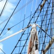 Masts and rope of sailing ship. - Stock Photo