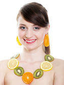 Healthy lifestyle - Young woman with fruits isolated — Stock Photo