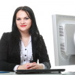 Modern business woman sitting at office desk — Stock fotografie