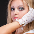 Portrait beautiful woman in white gloves — Stock Photo