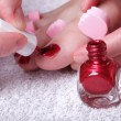 Female feet red polished nails — Stock Photo #26153023