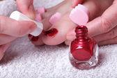 Female feet red polished nails — Stock Photo