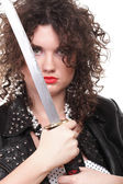Curly woman curly girl and sword — Stock Photo