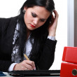 Modern business womsitting at office desk — Stock Photo #26955581