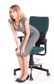 Affärskvinna med ryggsmärtor efter lång arbete på stol isolerade — Stockfoto