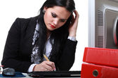 Modern business woman sitting at office desk — Stock Photo