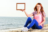Woman Holding Frame travel concept — Stock Photo
