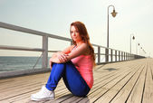Attractive girl Young woman pier sea — Stockfoto