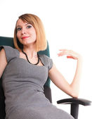 Happy excited young businesswoman, relaxing in office chair — Stock Photo