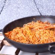 Boiling Spaghetti Pasta in a skillet — Stock Photo