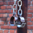 Fetters, manacles on brick background — Stock Photo