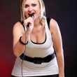Woman singing rock song microphone — Stock Photo