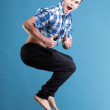 Young man jumping isolated gray background — Stock Photo #28602023